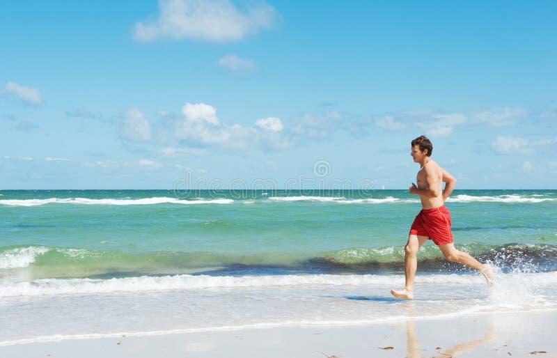 Download Man Running Along The Coast Stock Image - Image: 24065299