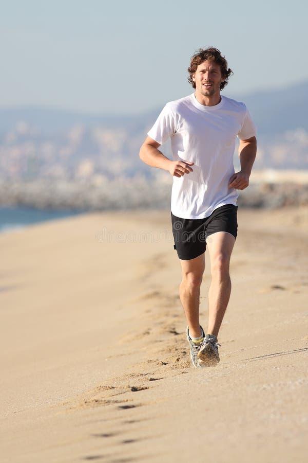 Man Running In The Beach Stock Photos