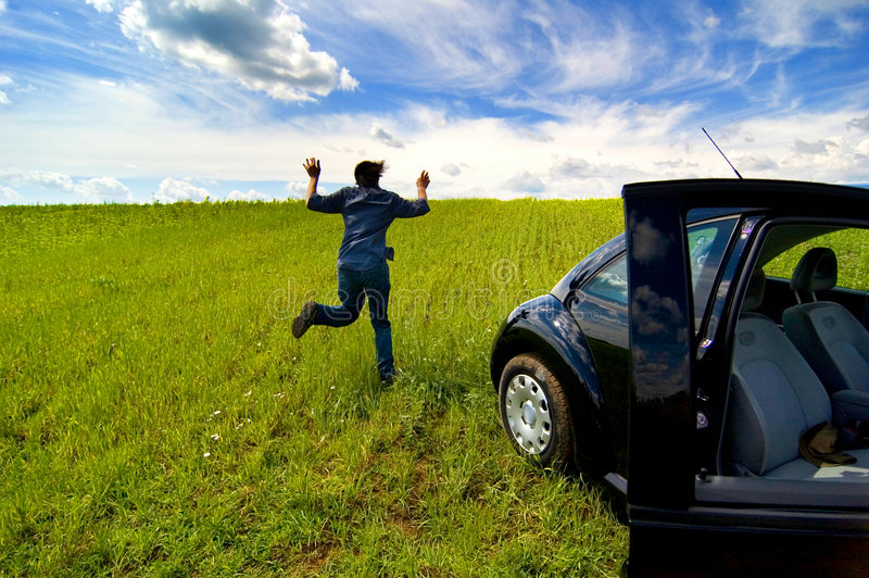 Download Man Running From Car In Open Field Stock Photo - Image of person, freedom: 1421470