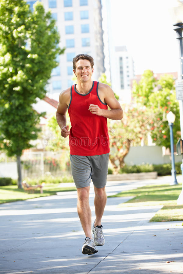 Download Man running in city park stock photo. Image of health - 20893312