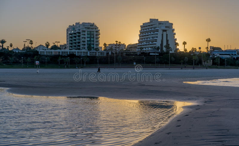 Man is running in the morning in Herzliya. MorningView of Herzliya`s SeeView at 6am stock photography