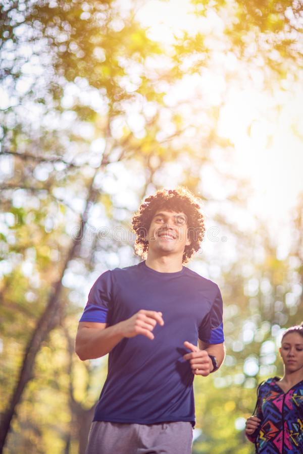 Man running at the nature- fitness, sport, training and lifestyle concept. royalty free stock image