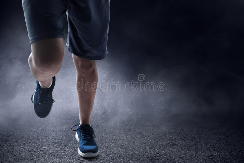 Man running outdoor on asphalt. Man running outdoor at night on asphalt royalty free stock images