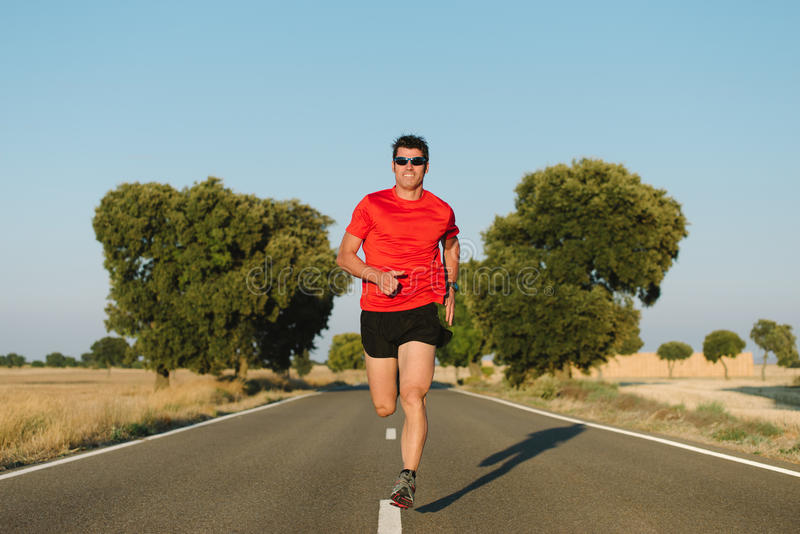 Man running on road royalty free stock photography