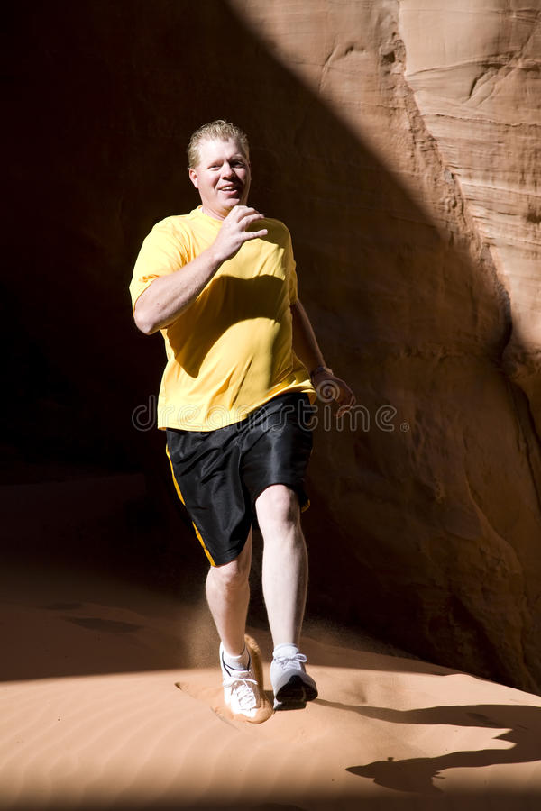 Man Running In Sand Royalty Free Stock Image