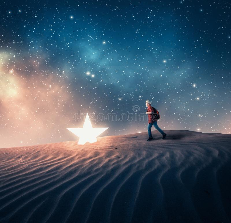 Running to a fallen star stock photography