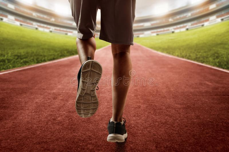 Man running on the track. Man run on the track stock photography