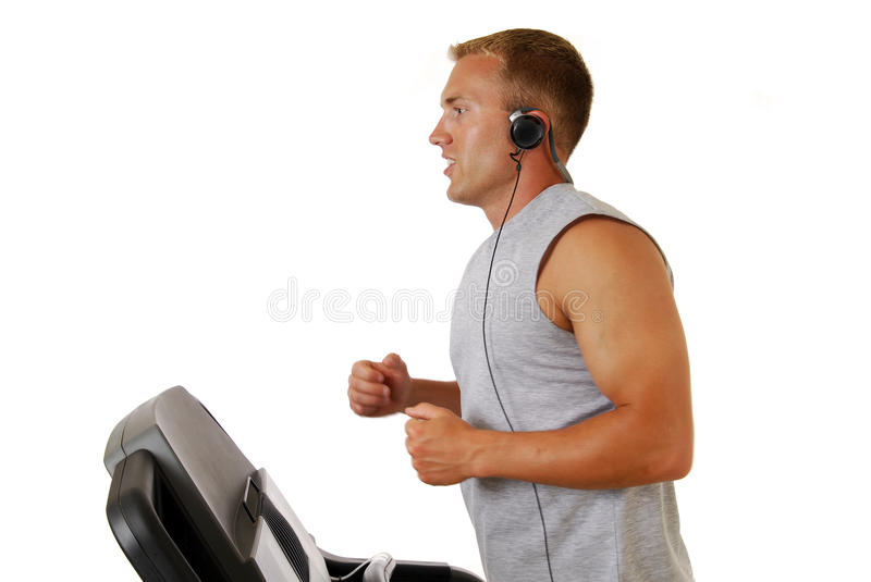 Download Man running on treadmill stock photo. Image of exercising - 10374548