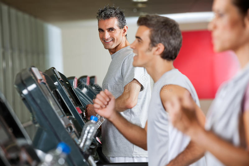 Man Running On Treadmill In Fitness Club royalty free stock photography