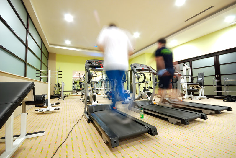 Download Man Running On Treadmill In Gym Royalty Free Stock Photography - Image: 7418727