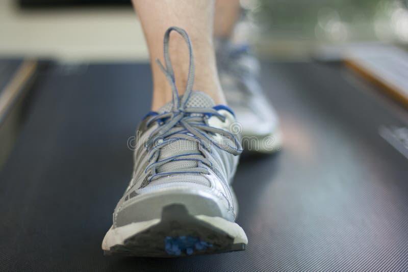 Man running on treadmill stock images
