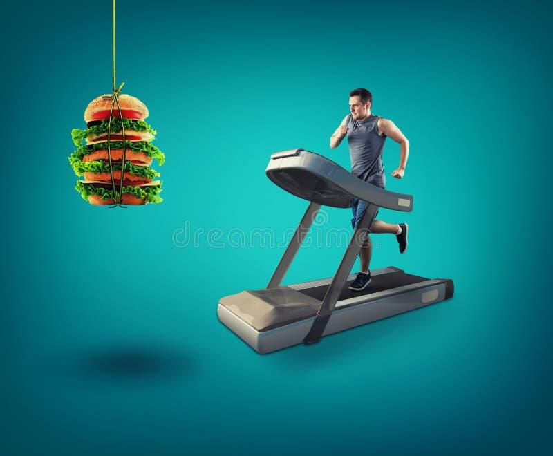 Motivation fitness. Man running on treadmill stock photography