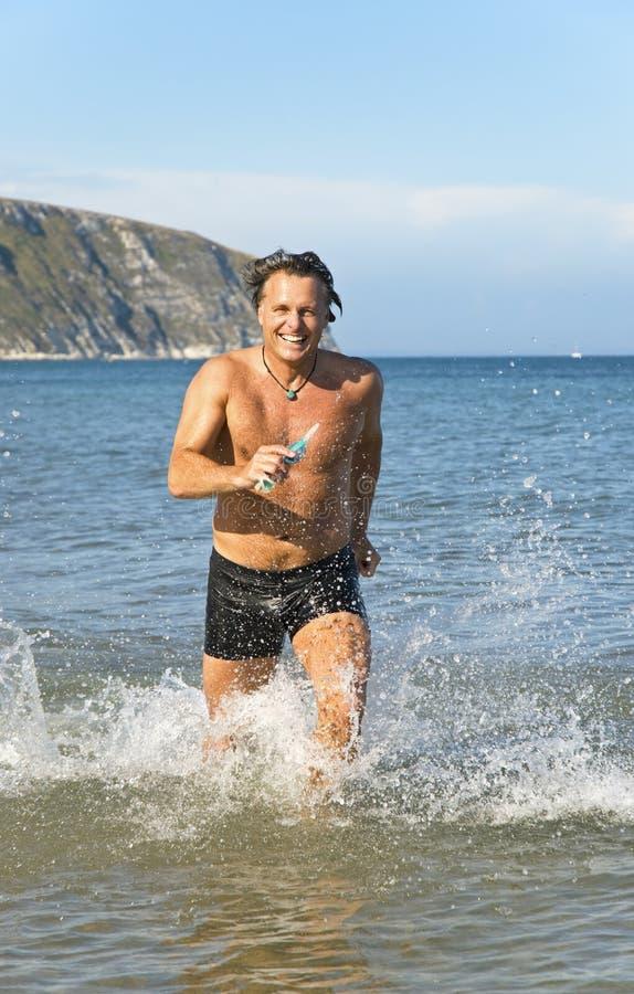 Download Man running in water. stock image. Image of pleasure - 10094721