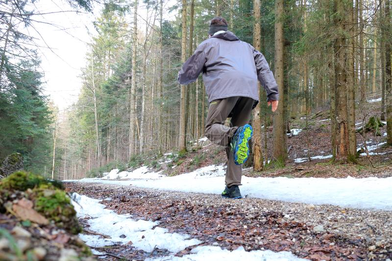 Man is running on way. Man is running in wood at winter stock photos