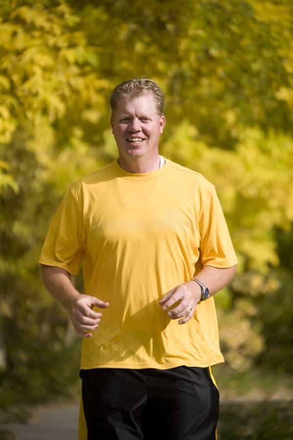 Man running in yellow