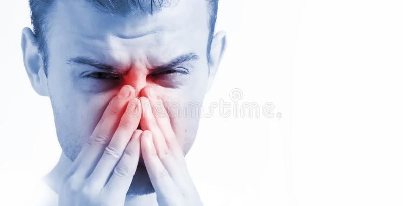 Man with runny nose on white background, in blue toning, ill with laryngitis royalty free stock photo