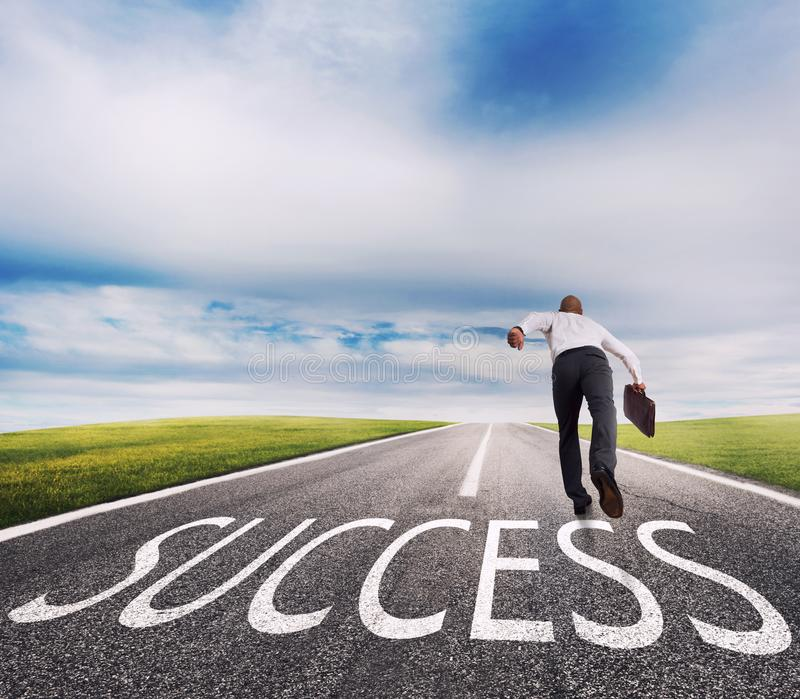 Man runs on a success way. Concept of successful businessman and company startup. Man runs fast on a success way. Concept of successful businessman and company royalty free stock photo