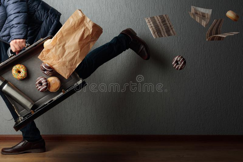 The man runs to the office: he is late and loses the contents of his briefcase. Copy space stock images