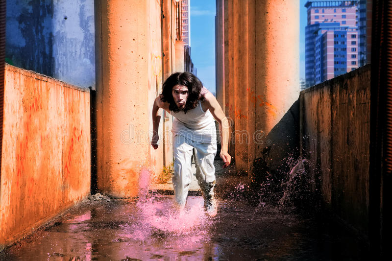 Download Man Runs On The Water Stock Photography - Image: 10548052
