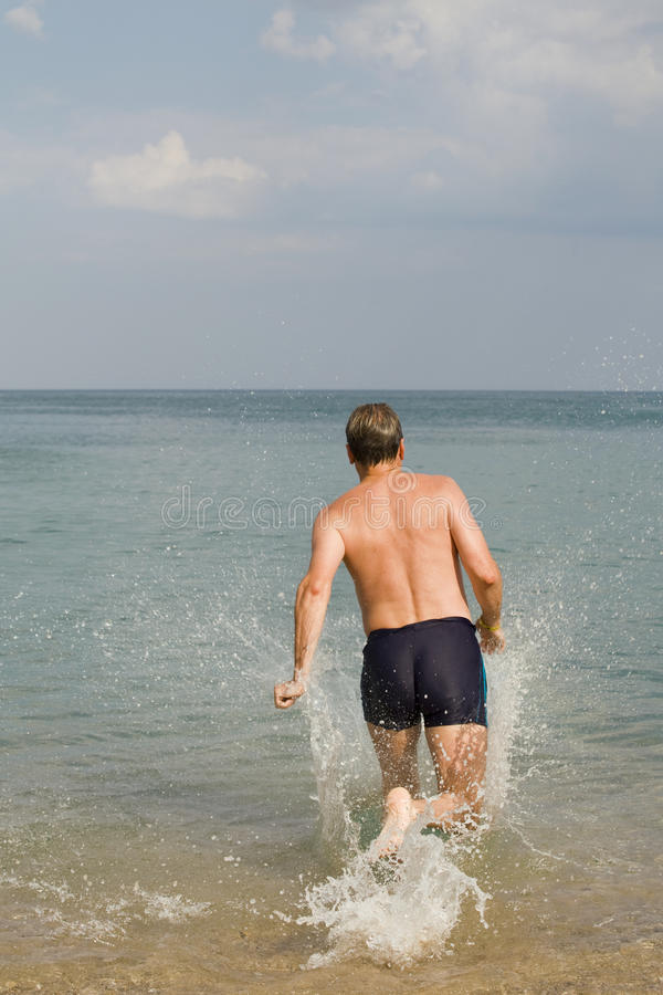 Download The man runs in water stock image. Image of holiday, travel - 18876177