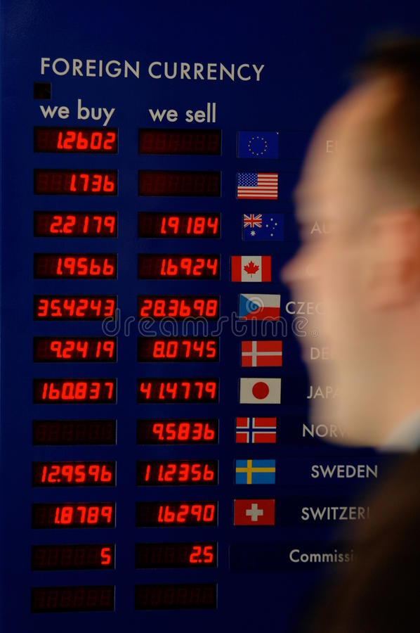 Free Man Rushing Past A Currency Exchange Board Stock Images - 9506434