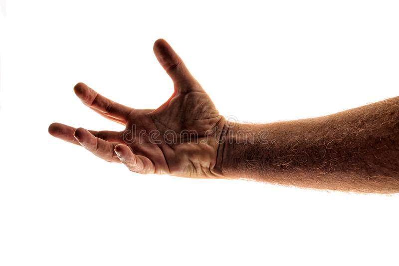 Man`s arm reaching out as if trying to grab at somethings, against white stock images