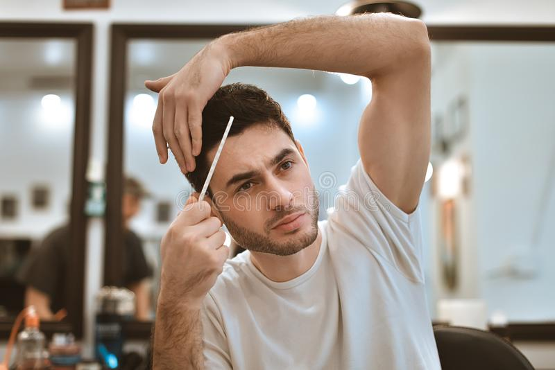 Man& x27;s body care. Self-styling hair. royalty free stock photography