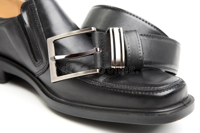 Man's boot and belt. On a white background royalty free stock photo