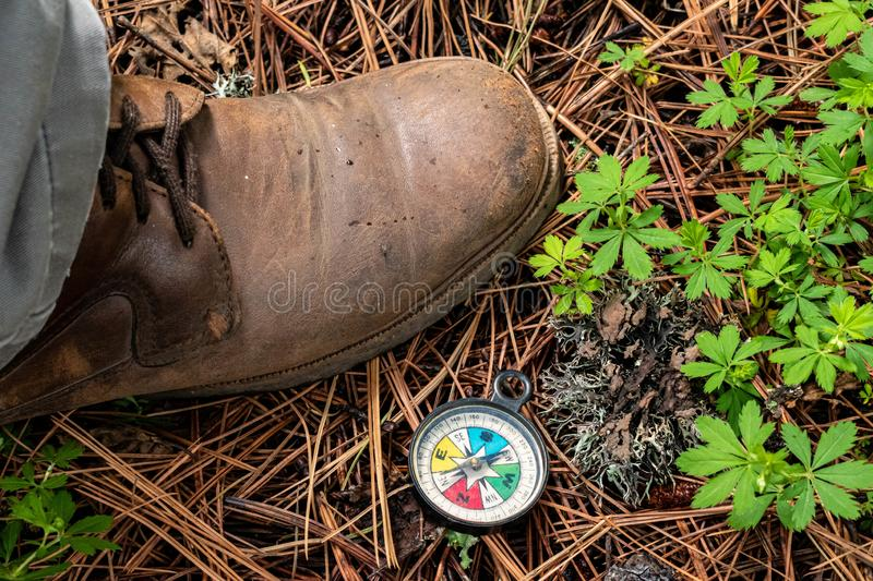 Man`s brown boot and a compass royalty free stock photos