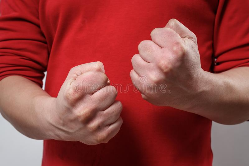 The man`s clenched fists. aggression, domestic or family violence. Family problems. concept royalty free stock images