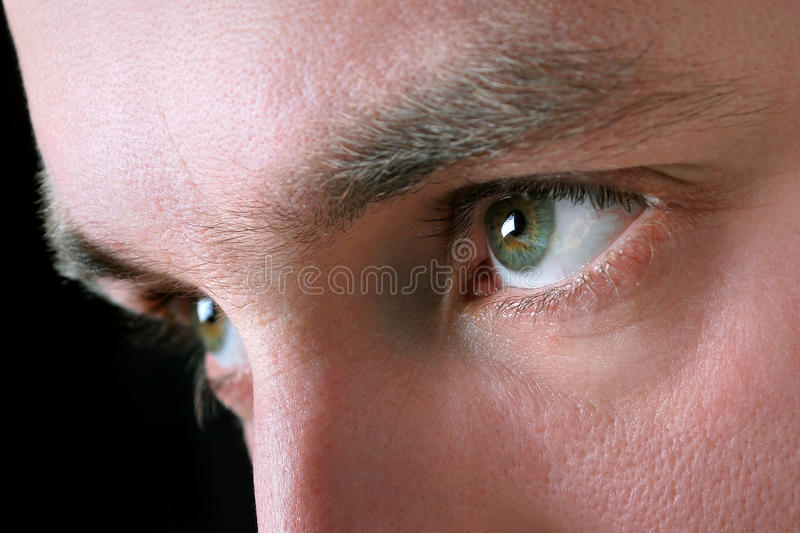 Man's eyes stock images