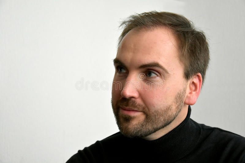 Man's face. Close up portrait of a good looking man with beard royalty free stock images