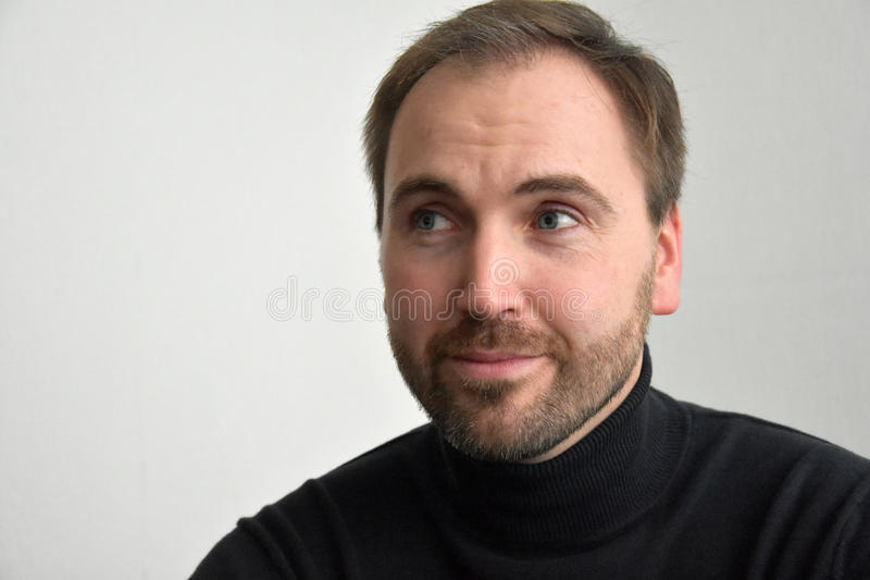 Man's face. Close up portrait of a good looking man with beard stock image