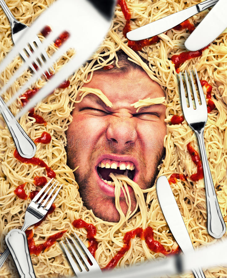 Man's face in pasta, closeup stock photos