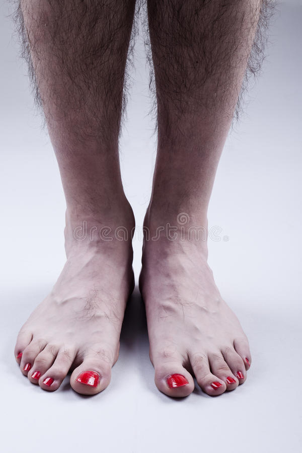 Man's Feet with Red Nail Polish royalty free stock images
