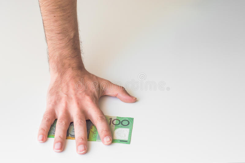Man's hand on Australian Dollar. Banknote royalty free stock photography