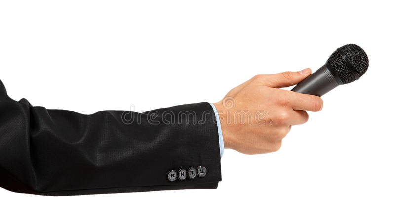 Man's hand in black suit holding a microphone. Isolated on white background stock images