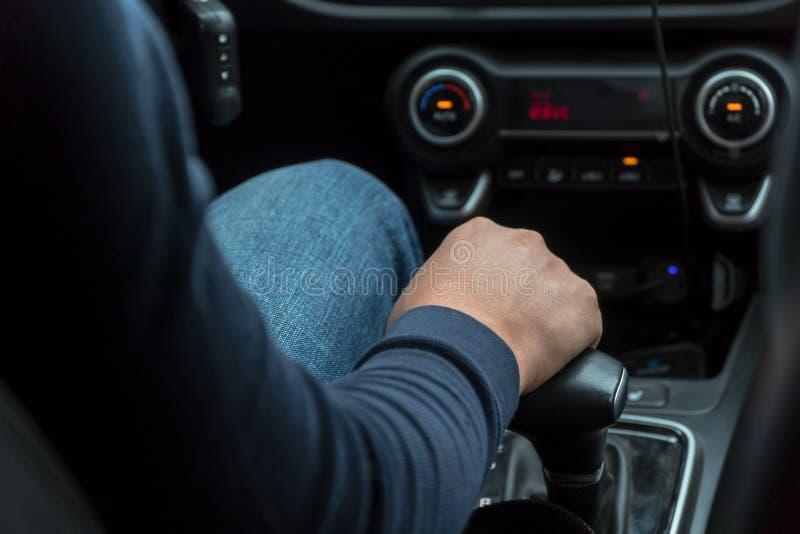 Man`s hand on car speed shift knob royalty free stock photos