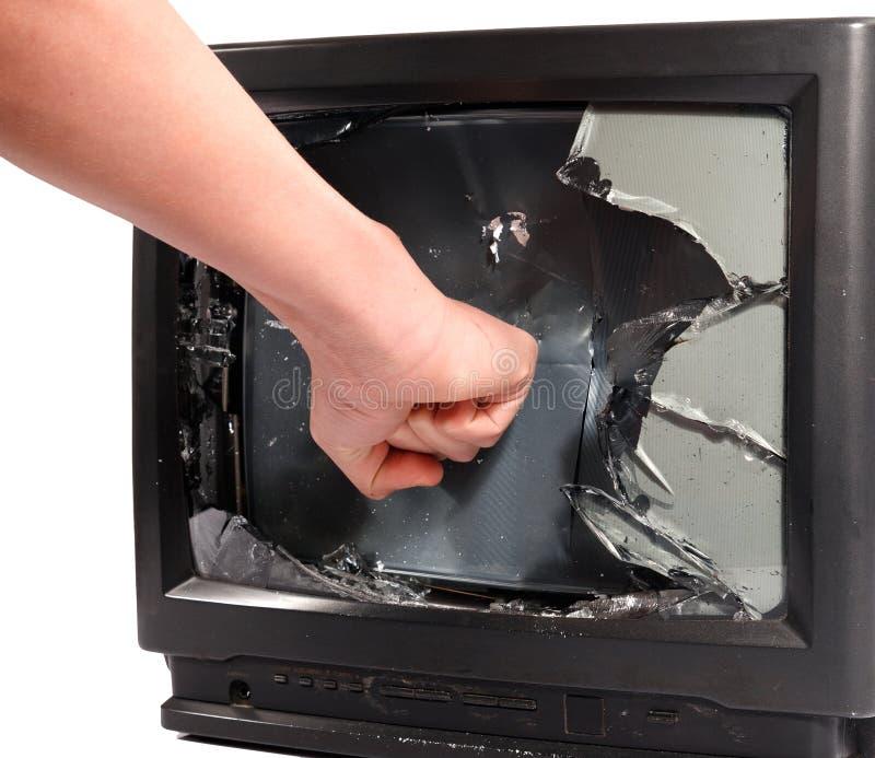 Man's hand crush television screen. Man's hand crush old television screen stock images