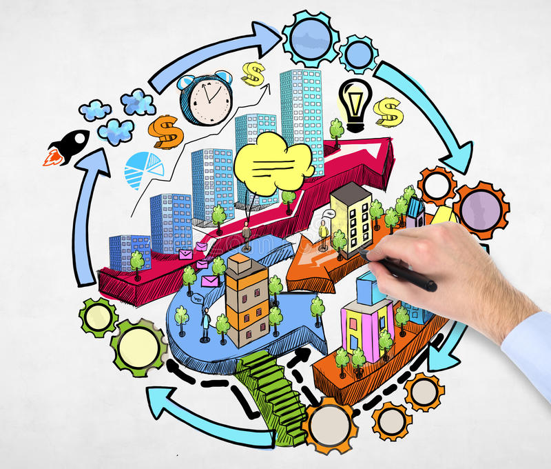 A man's hand is drawing a flowchart on the concrete wall with the colourful sketchs of city development concept. A businessman's hand is drawing a flowchart on royalty free stock photos