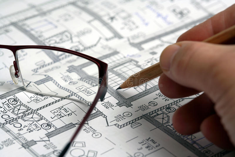 Man's hand draws a pencil business plan royalty free stock image