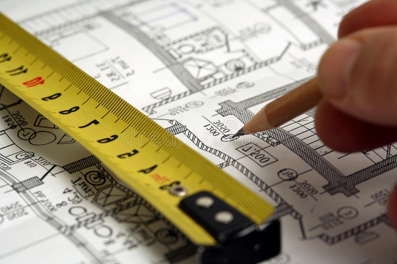 Man's hand draws a pencil business plan stock image