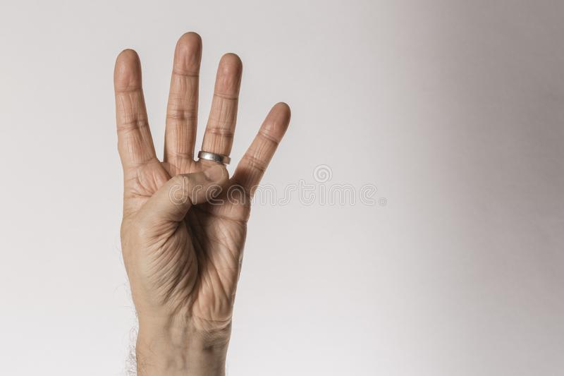 Man`s hand gesture, counting number four, isolated on white background - part of set royalty free stock photos