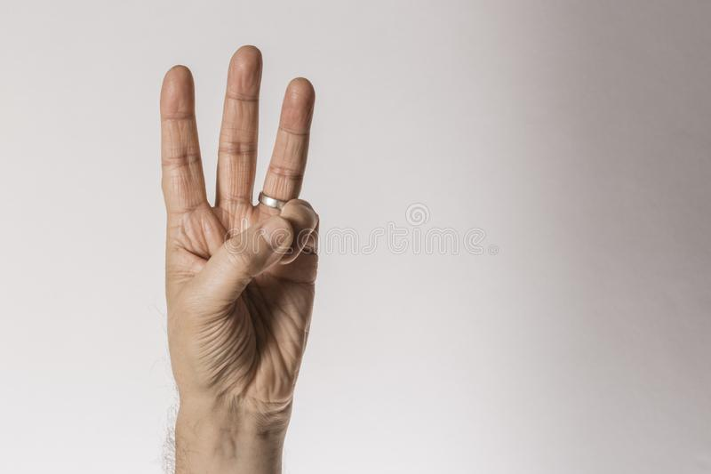 Man`s hand gesture, counting number three, isolated on white background - part of set stock photo