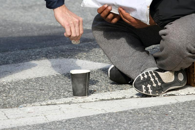 Man`s hand gives alms to the poor man stock photography