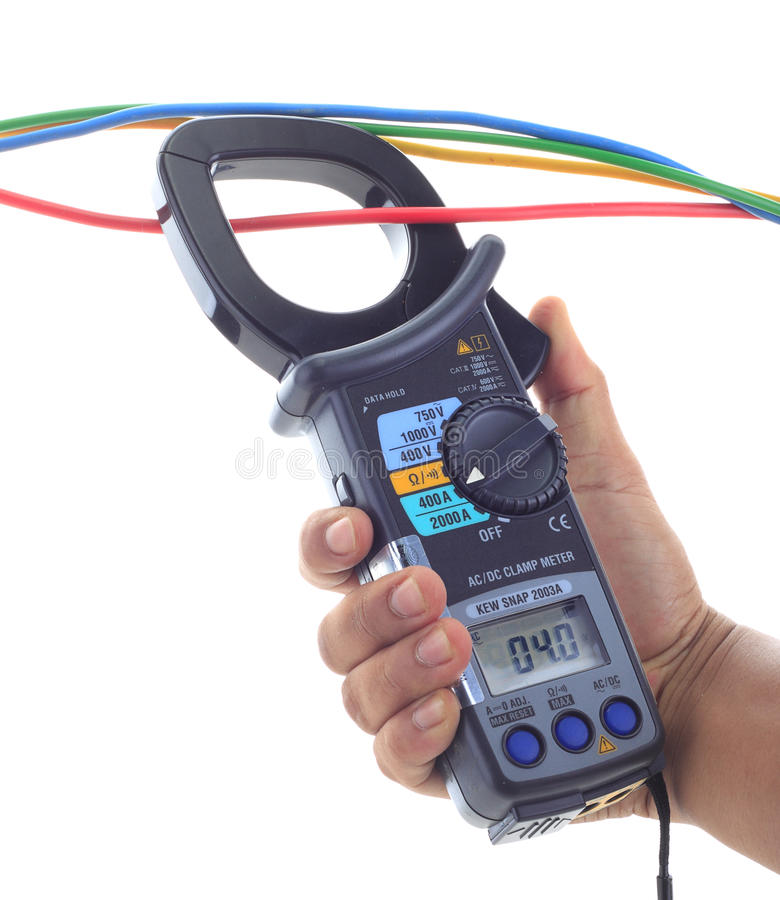 Man's hand hold AC and DC clamp meter stock images