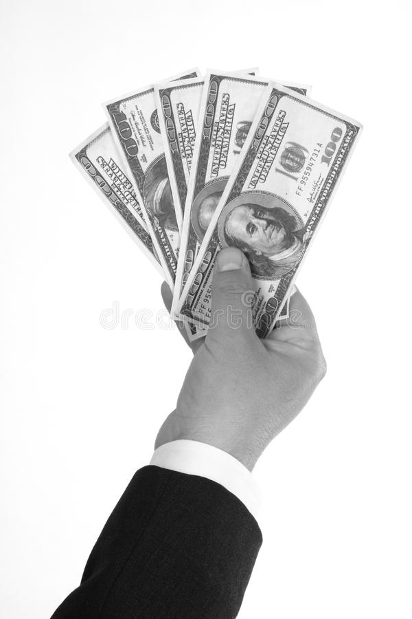 Man's hand holding dollar bills stock image