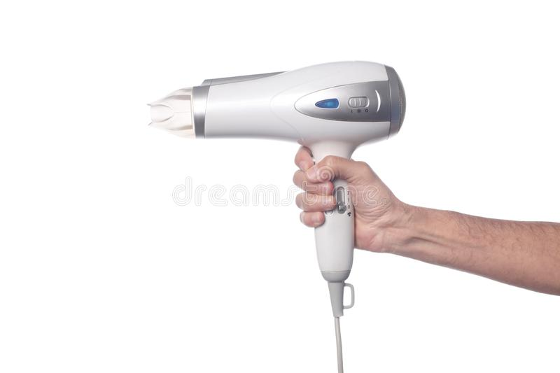 Man`s hand holding a hair drier isolated on white background with clipping path and copy space for your text stock photography