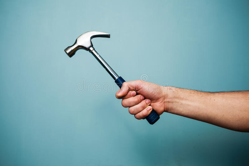 Download Man's hand holding hammer stock image. Image of male - 37850493