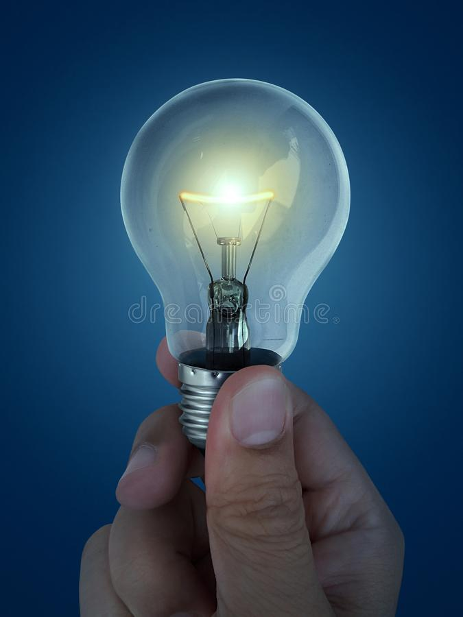 A man`s hand holding an Light bulb open, isolated, on white background royalty free stock images
